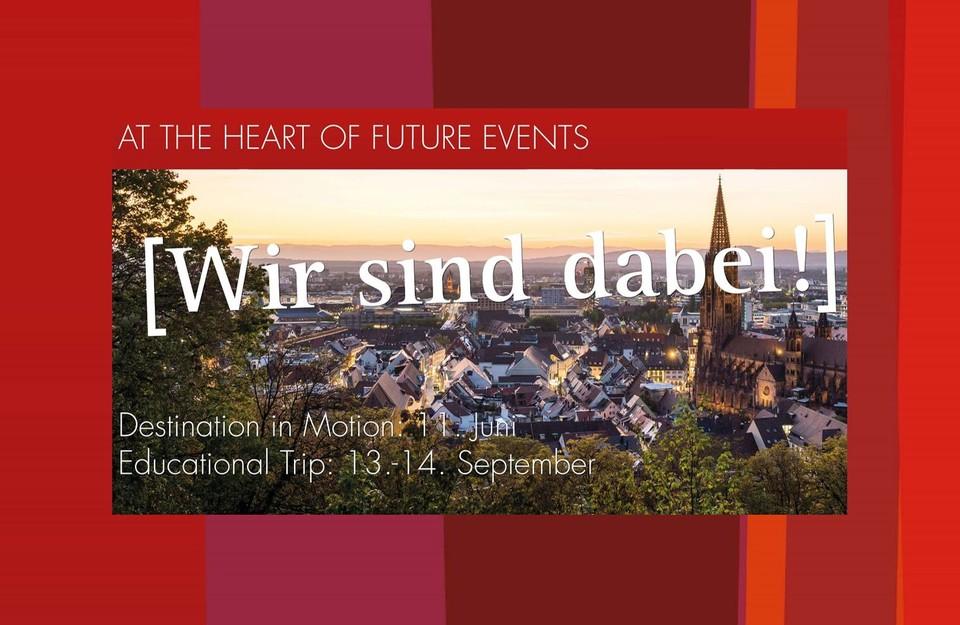 Blick auf die Stadt Freiburg mit Ankündigung zu Destination in motion am 11. Juni| Destination in motion